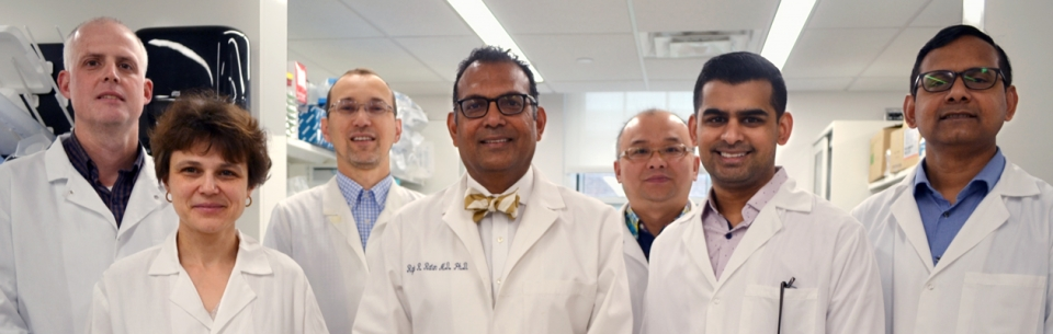 Dr. Rajiv Ratan (center) and his research team at the Burke Neurological Institute.
