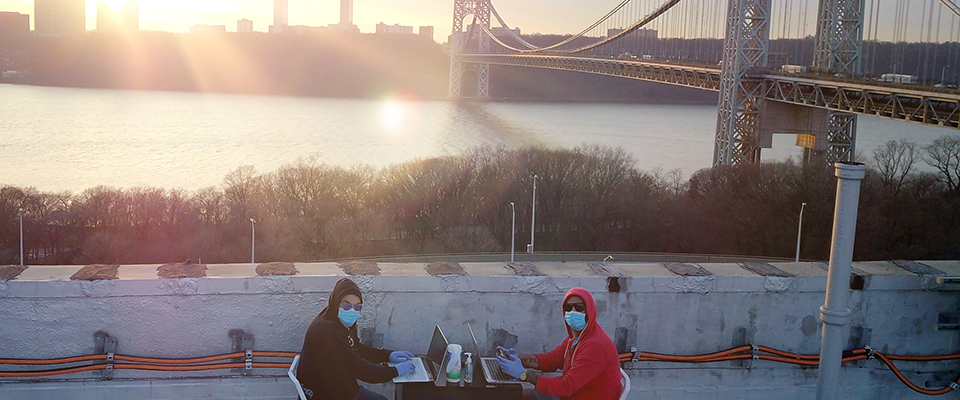 Cyril and Carlo working on their roof top