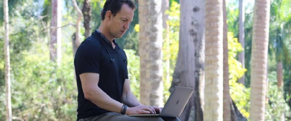 Dylan Edwards Working on Laptop